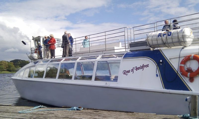 Tour enjoying boat tour on Lough Gill