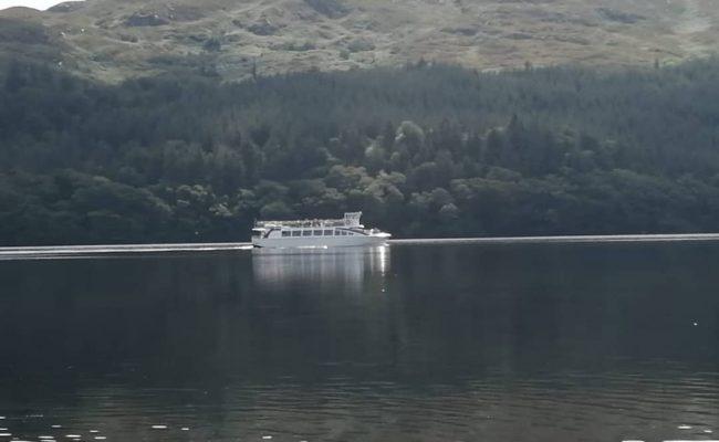 boat crossing a lake